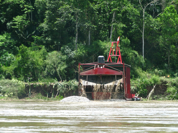 A brightly colored mining barge runs at full capacity on the Madre de Dios River in Peru in 2010. Such barges are rare on the river now, with most mining operations having moved further inland. Photo by Mrinalini Erkenswick Watsa