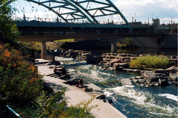 This modern, free-flowing, sustainable diversion structure incorporates natural building materials and native vegetation, along with considerations for natural fish passage and recreational uses on the South Platte River in Denver, Colorado (USA).