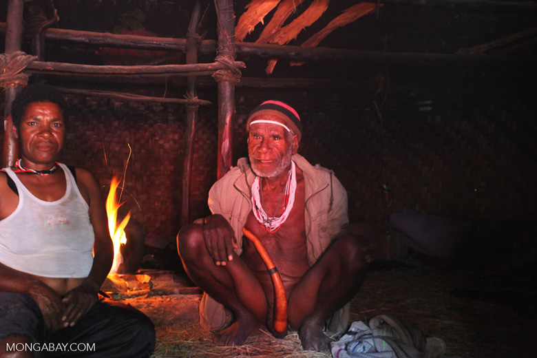 Group of Lani people in a hut