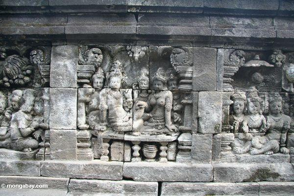 Mural wall carvings at borobudur women java for Mural indonesia