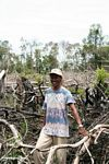 Thomas standing among charred jungle remains in Borneo (Kalimantan, Borneo - Indonesian Borneo)