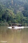 Boatload of tourists going up the Tembeling River