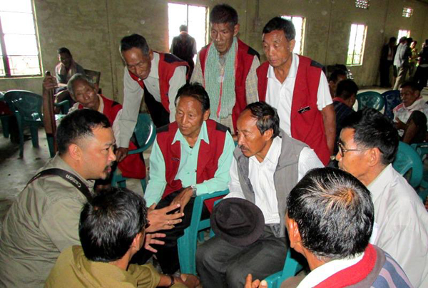 Steve Odyuo with village council members. Photo courtesy of Steve Odyuo.