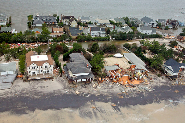 Damage to the town of Mantoloking, New Jersey after Hurricane Sandy.  Photo in the public domain.