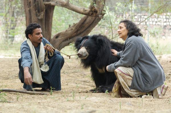 Geeta Seshamani with a Qalandar and his bear. Photo courtesy of WildlifeSOS-India.