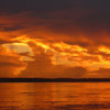 Sunset with storm clouds over the Amazon River near our destination