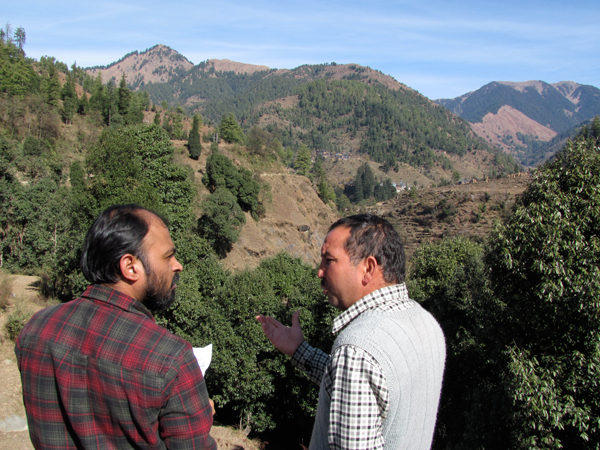 Ashwini Chhatre chats with an NGO worker in Himachal Pradesh, while working on the motivation project. Preliminary findings suggest that if a person receives only private goods (a chicken, a goat, for example) or information, they often shift from environmental to economic motivations. Therefore, once a project withdraws, the original intrinsic motivation to save forest that many people have naturally has been removed.   Photo credit: Pushpendra Rana.
