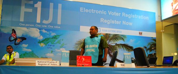 Fiji aims to register all legal age citizens to vote- placing a kiosk even at the airport to catch those traveling or living abroad.  By the end of March 2013 they had registered more than 500,000.  Fiji hasn't had a democratic election since the 2006 coup d'état.  Photo copyright © 2014 Amy West.