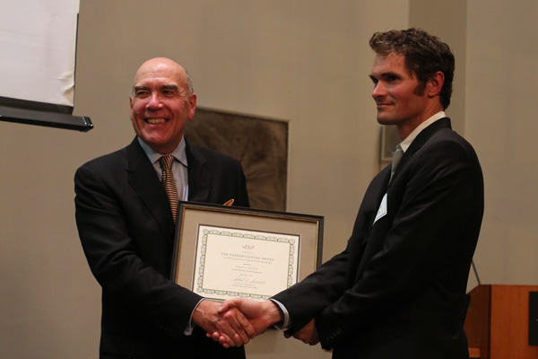 Field Museum President and CEO Dr. Richard Lariviere presenting the Parker/Gentry Award to Rhett Butler during a ceremony on September 3, 2014