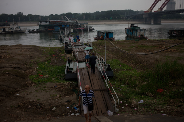 Passengers offload from a ferry on the Yangtze River. Boat traffic is a concern for wild porpoises but the larger threat comes from starvation.