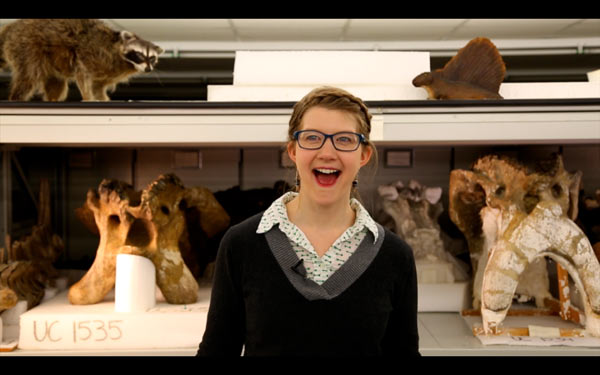 Emily Graslie, The Field Museum's Chief Curiosity Correspondent stands in front of the collection while filming a segment of The Brain Scoop - an video blog that goes behind-the-scenes at Chicago's Field Museum and highlights the fun, freaky, and fantastic of the natural world. Photo courtesy of: Emily Graslie & The Field Museum