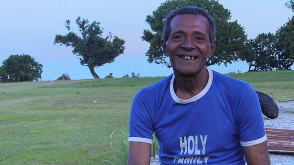 The chief of Waitabu village, Eroni Vuniivi, sports a 'Holy Family' shirt. Chiefs together with priests command the most respect in Fiji. Photo by Amy West
