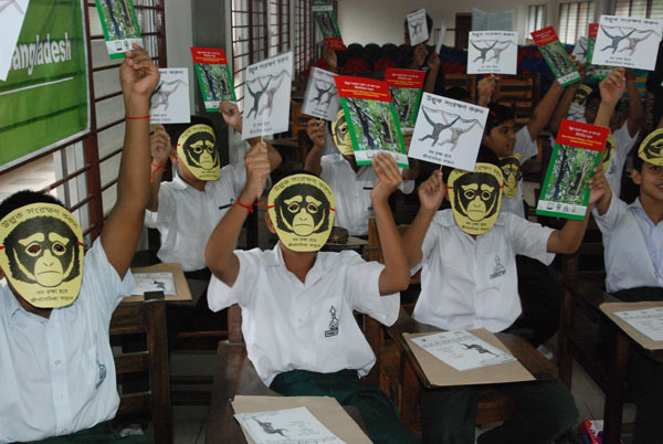 Children in Bangladesh participating in an environmental education program about hoolock gibbons. There are two species of gibbon: the Eastern hoolock gibbon (Hoolock leuconedys) is listed as Vulnerable by the IUCN, and the Western hoolock gibbon (Hoolock hoolock) is listed as Endangered by the IUCN. Source: Corrin LaCombe.