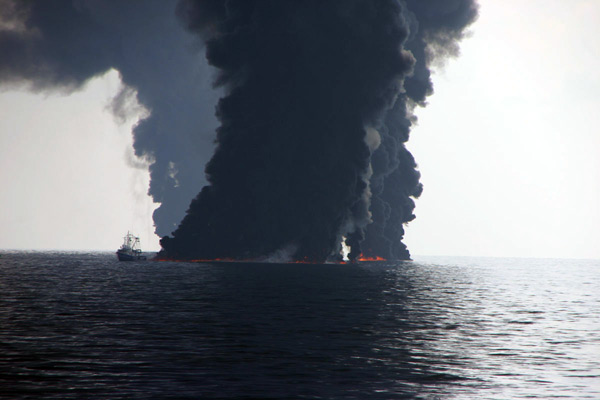 A controlled burning of Macondo well oil from the Deepwater Horizon disaster that rose to the ocean surface. Image courtesy of David Valentine..