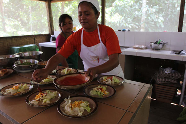 Women prepare meals for tourists visiting San Miguel del Bala through its community tourism operation. Photo by Barbara Fraser