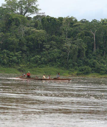 Local community members paddle their canoe on the Rio Tambopata in the rainforest of Peru. Photo by Rhett A. Butler / mongabay.com