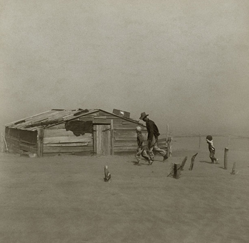 Family taking shelter during a dust storm in Oklahoma during the droughts of the 1930s. Photo by: Arthur Rothstein, for the Farm Security Administration.