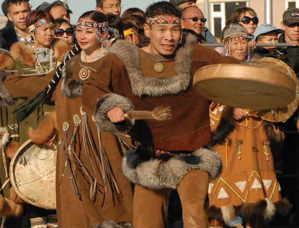 Chukotkan dancers. Subsistence hunting will be increasingly difficult for the Inuit who depend on marine mammals in the Arctic to provide them with food and materials for clothing. Photo by: Edward Struzik.