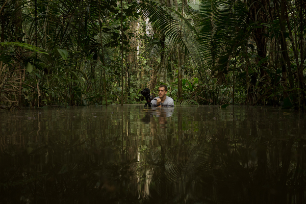 Thompson filming in a flooded forest. Photo by: Tristan Thompson.
