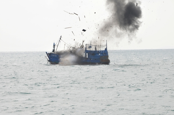 A fishing boat, which was flying Indonesian colors, is sunk off the coast of Riau, Sumatra on February 9, 2015, after the fishery ministry evacuated the all-Thai crew. Photo courtesy of the Indonesian Ministry of Fisheries.