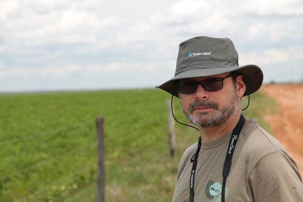 Herpetologist Reuber Brandão ponders a soy plantation on the edge of Grande Sertão Veredas National Park in the Brazilian Cerrado. Photo credit: Brendan Borrell