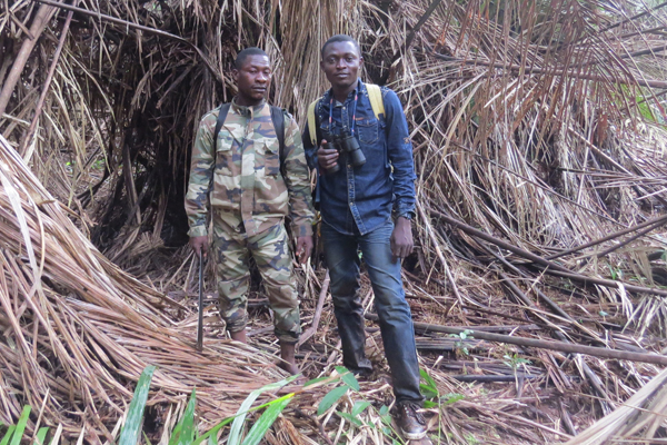 Gaël Elie Gnondo Gobolo on the right and a park ranger on the left. Photo by: Lieven Devreese.