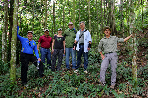 Fito Steiner, a well-known Honduran environmentalist and a co-founder of the Pico Bonito National Park Foundation (far right), with the author (center, in green shirt) and EcoLogic group Honduras. Photo credit: Pat Goudvis.