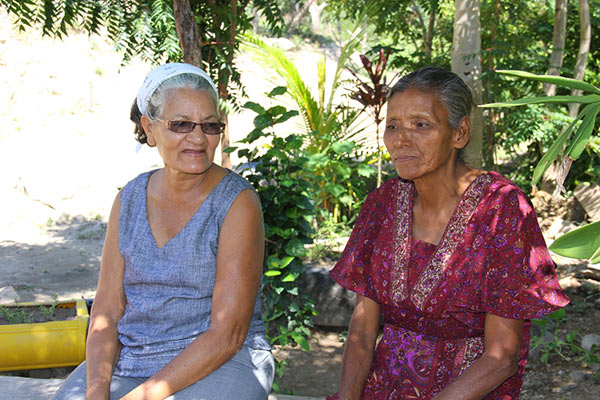 Nilia Zumilda Duarte Sandoval, retired school teacher and AJASSPIB treasurer (left), with Pico Bonito community member. Photo credit: Pat Goudvis.