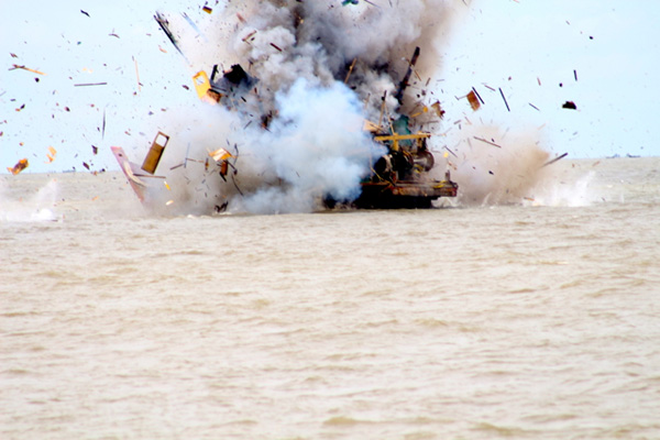 A Malaysian-flagged vessel was blown up in the waters of Belawan for illegal fishing in Indonesian waters. Photo: Ayat S Karokaro.