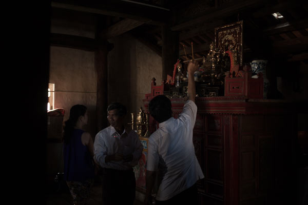 Residents make offerings at a temple in Ly Son Island.