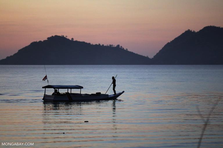 Fishing boat off Labuan Bajo at sunset