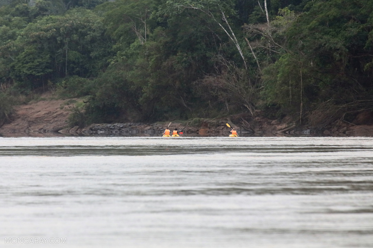 Ecotourists in kayaks in the Amazon