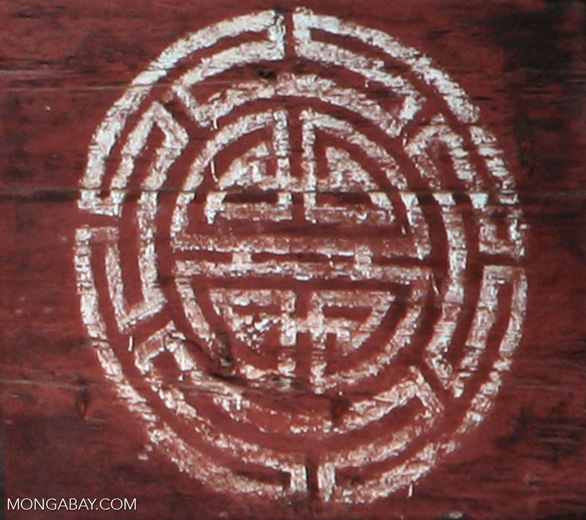 Patterns painted on a red barn in Tibetan Yunnan