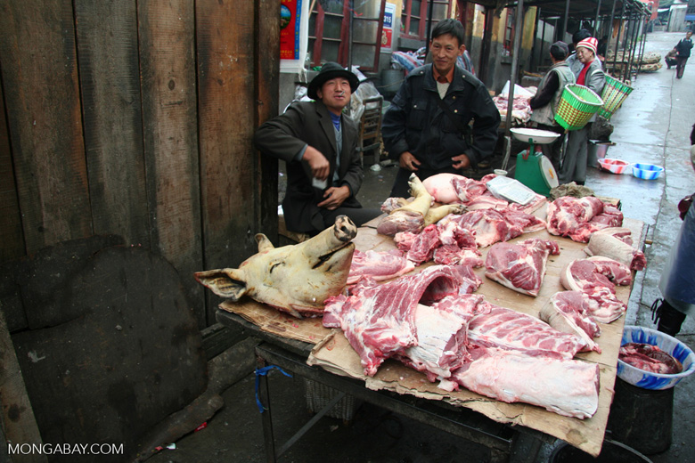 Sellers at the Deqin meat market