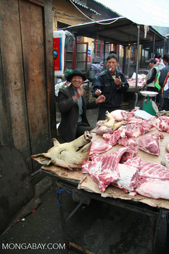 Sellers at the meat market in Dechen