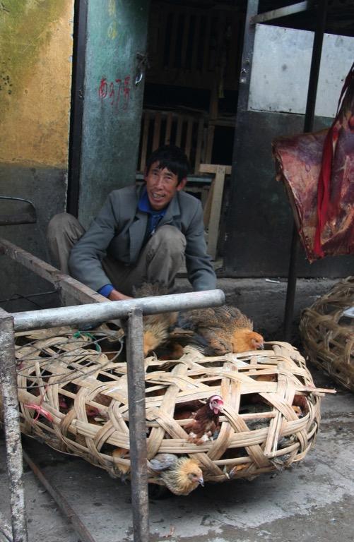 Meat (poultry) seller in Deqin