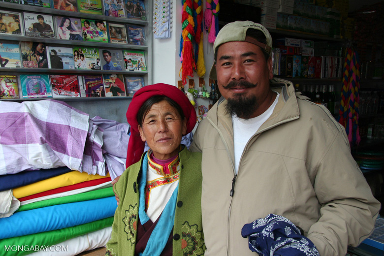 Tibetan woman with a private tour guide in Deqin