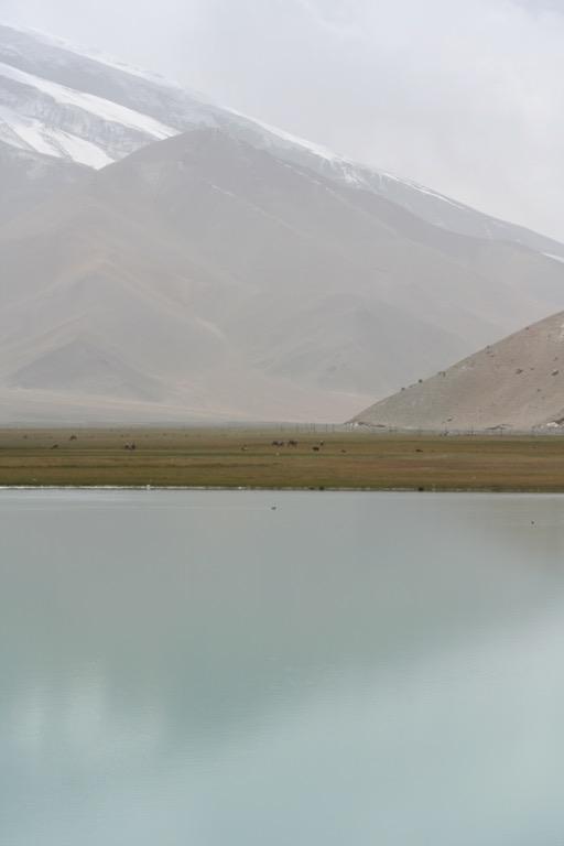 Muztag Ata reflected in a turquoise lake