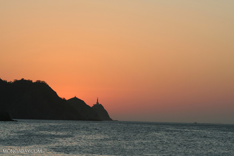 Sunset over the Caribbean sea at Taganga lighthouse