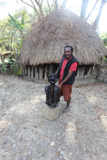 Papuan man displaying the 350-year-old Aikima mummy