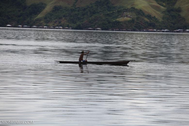 Man canoeing in Lake Sentani