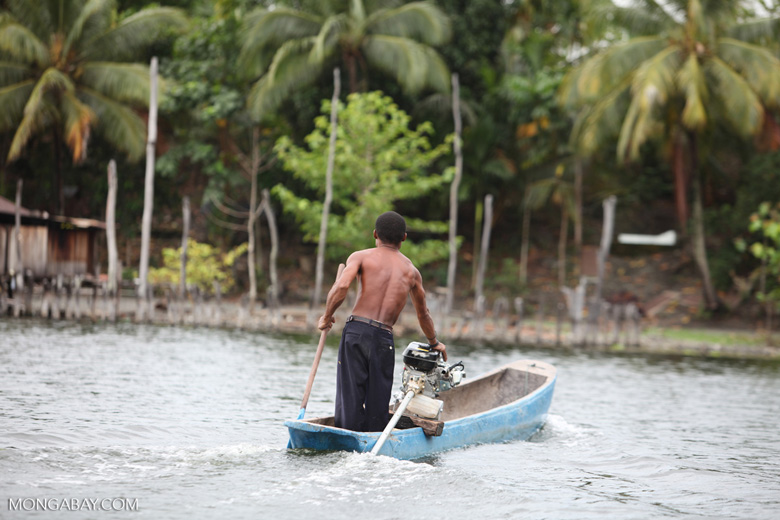 Sentani man in a fishing canoe