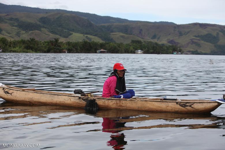 Woman in a canoe on Lake Sentani