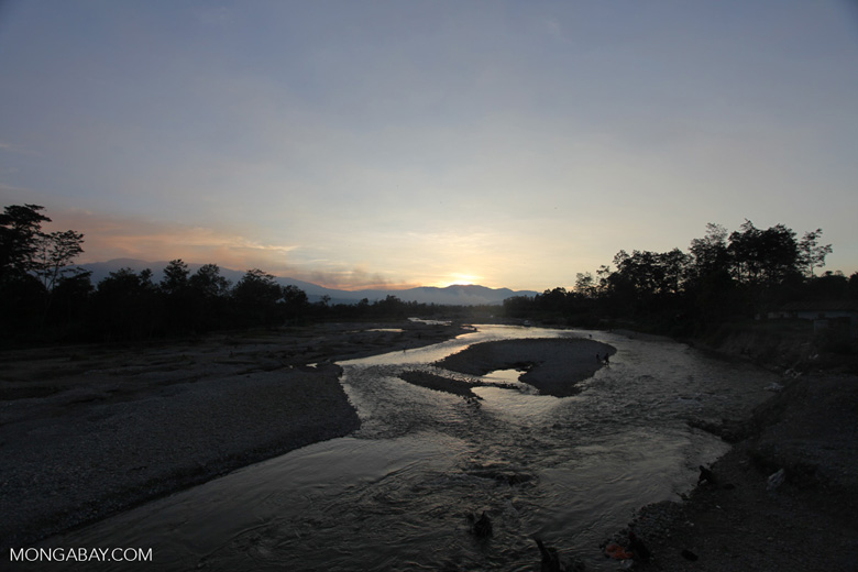 Papuans washing their laundry in a highland river
