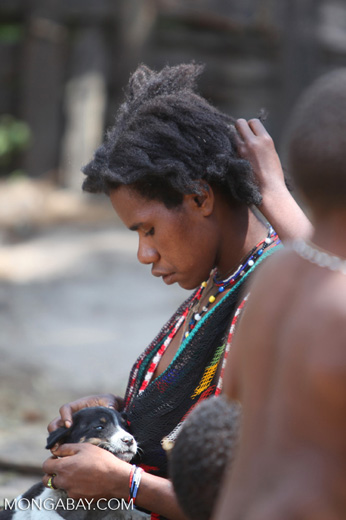 Papuan girl doing another's hair
