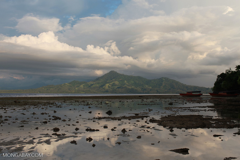 Tidepools on Bunaken Island with the Sulawesi mainland in the distance