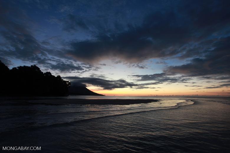 Bunaken sunset with Manado Tua volcano in the background