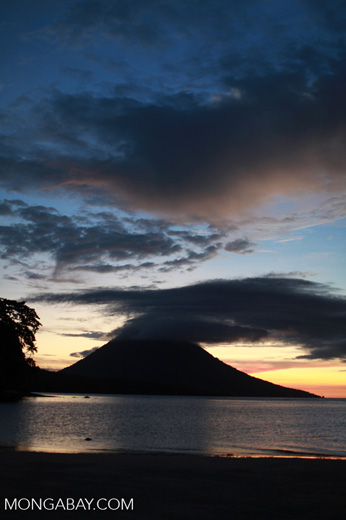 Bunaken sunset with Manado Tua volcano in the background