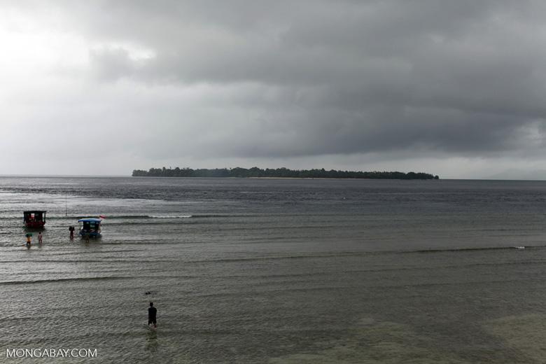 Men loading a boat off Bunaken Island