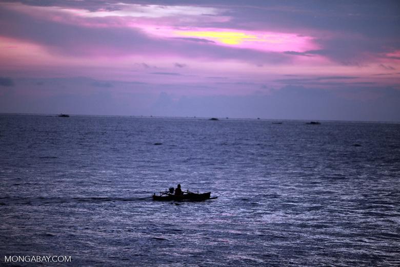 Fishermen at dawn on the Lembeh Strait